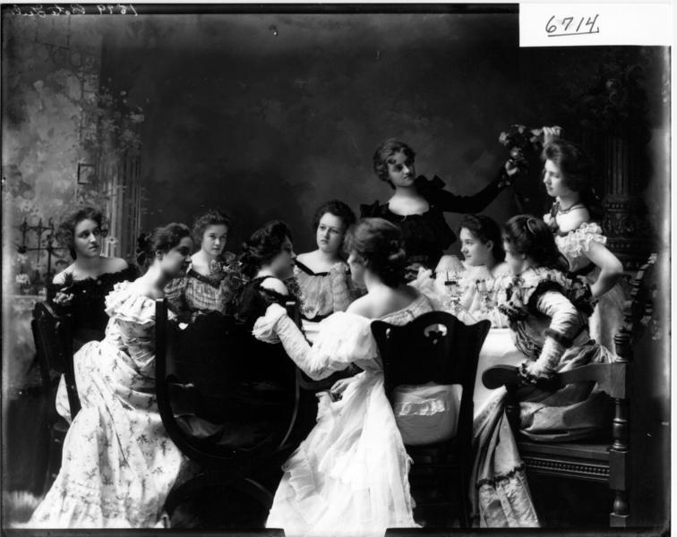 Beta girls gathered around table ca. 1899 %283192606910%29